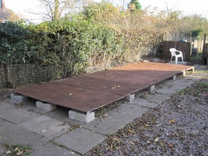 The base of our new shed lying on breeze blocks and the existing paving
